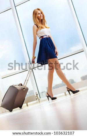 Young woman walking with travel bag. - stock photo