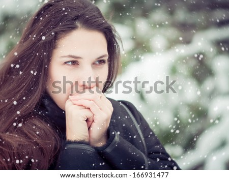 Young woman warming her hands in winter  - stock photo