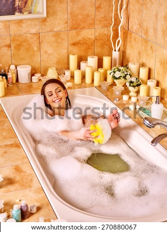 Young woman wash leg in bathtube. Girl washes heel. - stock photo