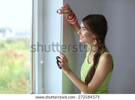 Young woman watching footage on film - stock photo