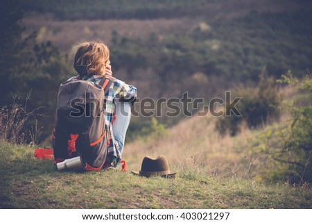 Young woman watching landscape, posing outdoor. Active lifestyle concept.  - stock photo