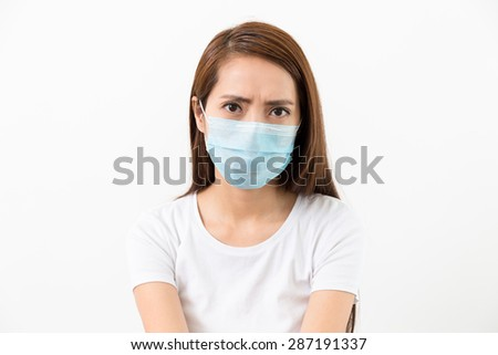 Young woman wear with face mask - stock photo
