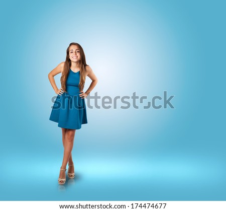 young woman wearing a blue dress at a blue room - stock photo
