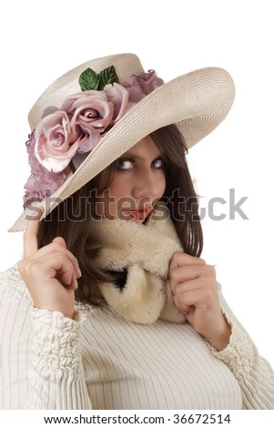 Young woman wearing a fancy mauve and cream organdy hat; isolated on a white background. - stock photo