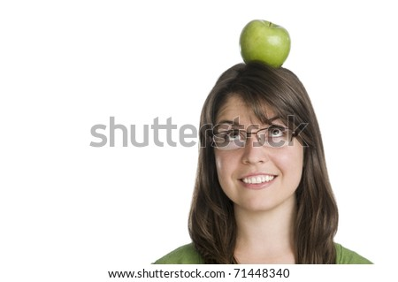 young woman wearing a green top interacting with a green apple, copy space,expressions - stock photo