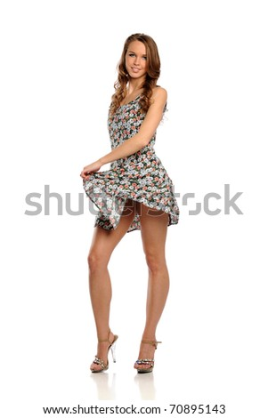 Young Woman wearing a summer dress isolated on a white background - stock photo