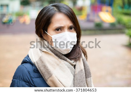 Young woman wearing face mask - stock photo