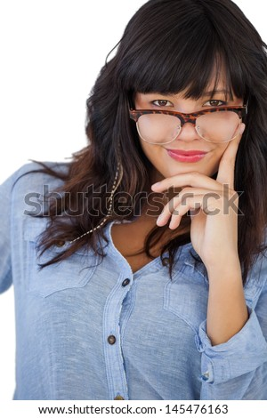 Young woman wearing glasses with her hand on hip on white background - stock photo