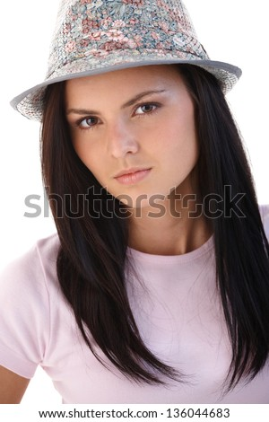 Young woman wearing hat, looking at camera. - stock photo