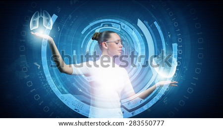 Young woman wearing headphones on digital background touching media screen - stock photo