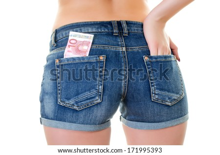 Young Woman wearing jeans texas shorts with Cash in Back Pocket  over white background - stock photo