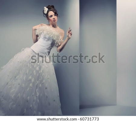 Young woman wearing wedding dress - stock photo