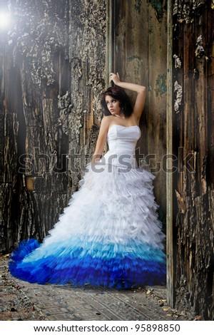 Young woman wearing wedding dress - stock photo