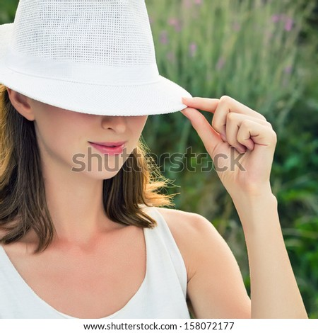 Young woman wearing white hat  - stock photo