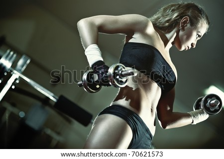 Young woman weight training. Camera angle view. - stock photo