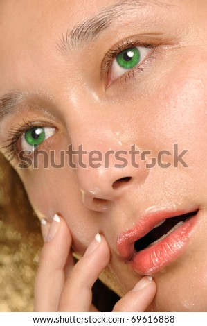 Young woman wet crying face - stock photo