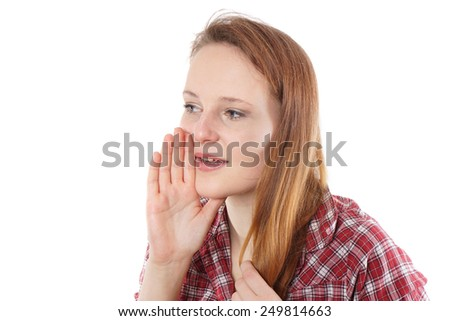 young woman whispering and covering her mouth wih hand - stock photo