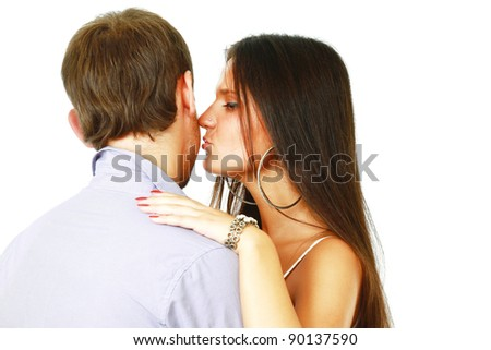 Young woman whispering something to young man isolated on whire background - stock photo