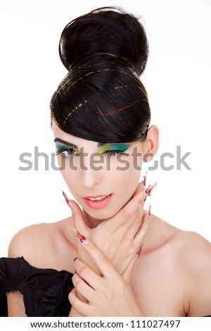 Young woman winking at you while holding her hands in a choking position against white. - stock photo