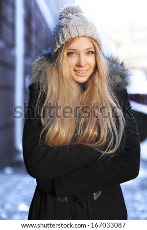 Young woman winter outdoors portrait. - stock photo