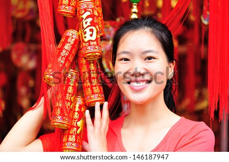 young woman wishing a happy chinese new year - stock photo