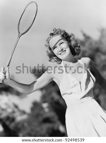 Young woman with a badminton racket - stock photo