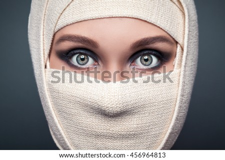 young woman with a bandaged face - stock photo