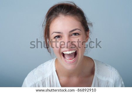 young woman with a beautiful smile - stock photo