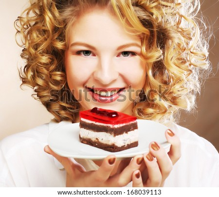 young woman with a cake - stock photo