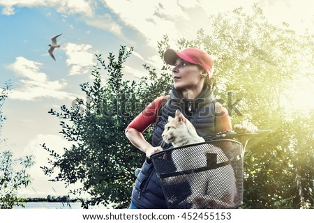 Young woman with a cat. - stock photo
