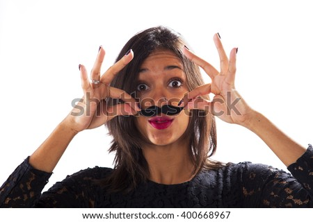 Young woman with a fake mustache - stock photo