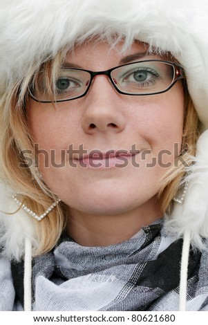 Young woman with a fur cap, portrait - stock photo