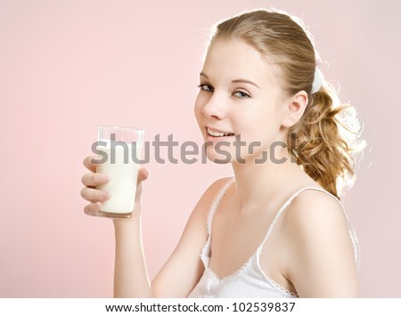 Young Woman with a glass of milk - stock photo