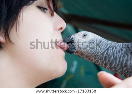 young woman with a grey parrot - stock photo