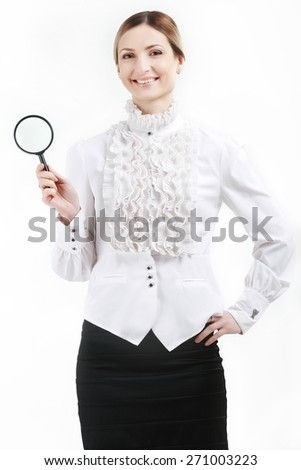 Young woman with a magnifying glass  - stock photo