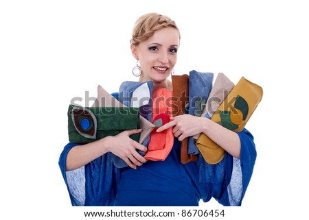 young woman with a purse collection, isolated on white background - stock photo