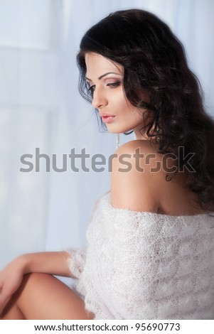 Young woman with a shawl on her shoulders - stock photo