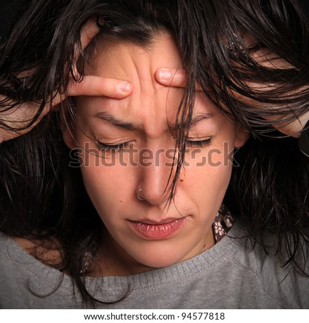 young woman with a splitting headache - stock photo