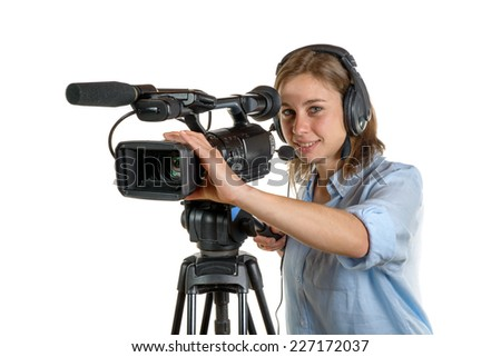 young woman with a video camera and headphone - stock photo