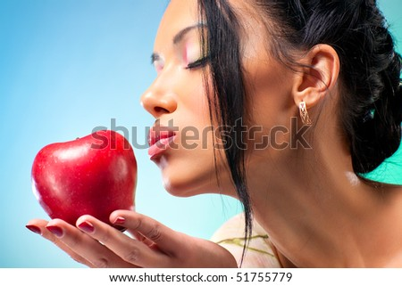 Young woman with apple. Rich bright colors. - stock photo