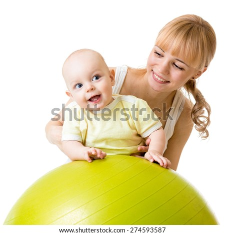 Young woman with baby son doing gymnastic on fitness ball - stock photo
