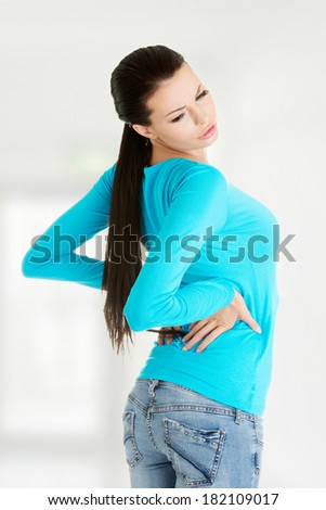 Young woman with backache - stock photo