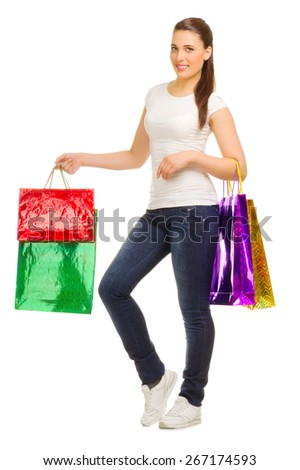 Young woman with bags isolated - stock photo