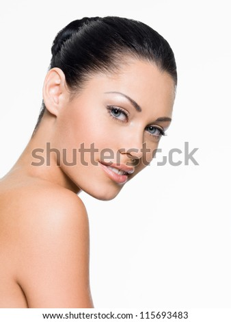 Young woman with beautiful face - isolated on white - stock photo