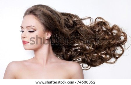 Young woman with beautiful long curly hair - white background - stock photo
