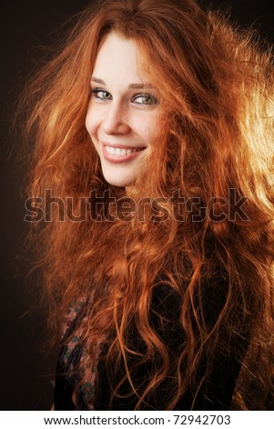 Young woman with beautiful long fluffy hair - stock photo
