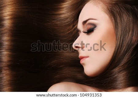 Young woman with beautiful  long hair - stock photo