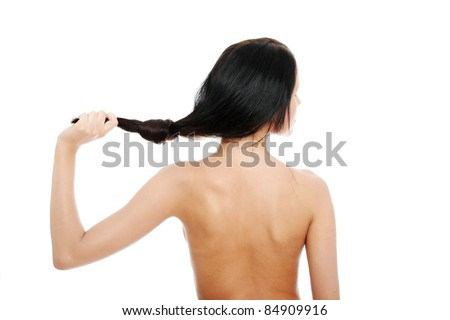 Young woman with beautiful long hairs - stock photo