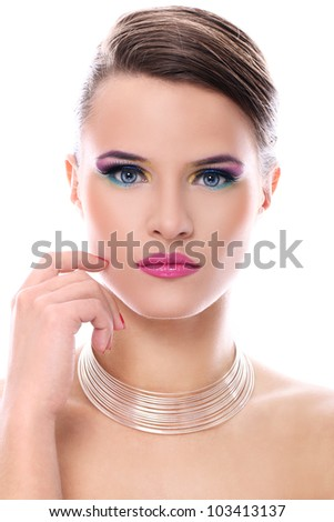 Young woman with beautiful make-up over white background - stock photo