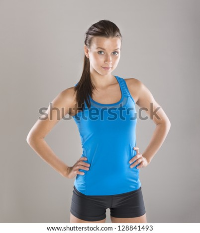 Young woman with beautiful slim body in sport clothes. - stock photo